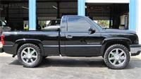 Austin B.'s Chevrolet truck with 35'' Nitto Trail Grapplers on 22'' Cadillac Rims